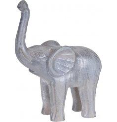 A large white washed wooden elephant