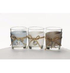 An assortment of 3 nautical themed tealight holders