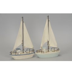 An assortment of 2 wooden sailing boat ornaments