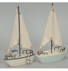 2 beautifully simple wooden sailboats finished in a distressed style