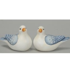 2 beautifully simple wooden seagulls, finished in a distressed whitewash style