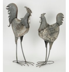 An assortment of standing cockerel garden figures