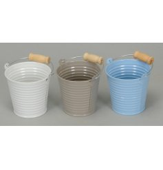 An assortment of 3 pastel toned buckets