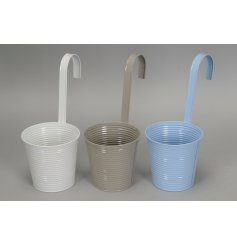 An assortment of pastel toned metal planters