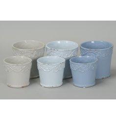 An assortment of pastel toned ceramic planter pots