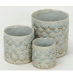 A beautifully patterned set of 3 planters