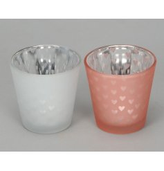 Bring a chic touch to any home or display with these small pink themed glass pots