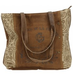A highly distressed vintage handbag