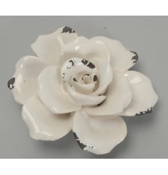 A beautifully distressed styled ceramic rose