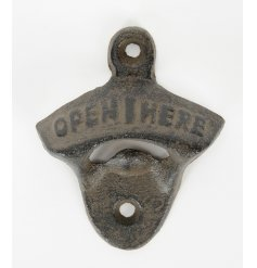A distressed iron garden bottle opener