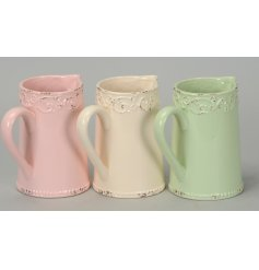 A stylishly chic assortment of coloured ceramic jugs