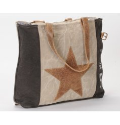 A stylish faux leather hand bag with a distressed touch