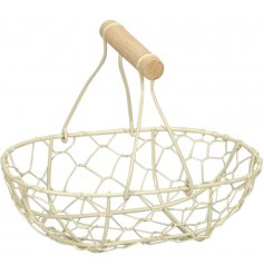A simple yet sweet wire basket complete with wooden handle