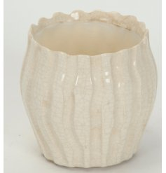 A beautifully glazed ceramic pot, finished in a crackled pearl tone