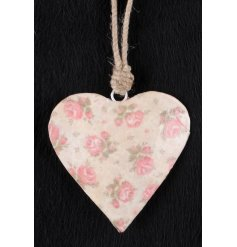 A sweet little hanging metal heart with a pink floral design