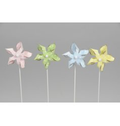 An assortment of 4 pastel toned pinwheels in pink, blue, yellow and green colours