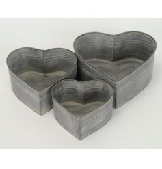 Bring a distressed touch to any home or garden with these rustic inspired heart planters