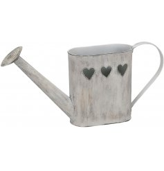 charming distressed watering can with heart detailing.