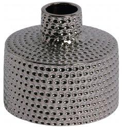 A gunmetal toned hammered vase
