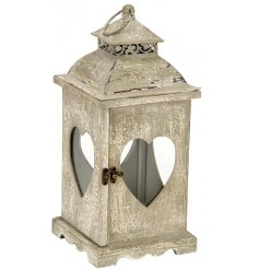 A candle lantern with heart window