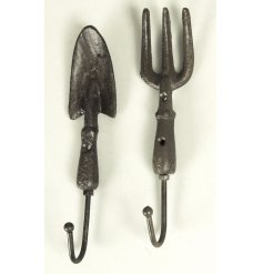 An assortment of 2 hooks shaped as garden tools