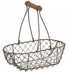 A grey wire oval basket with a long handle
