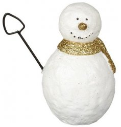 A small snowman with a spade and gold scarf