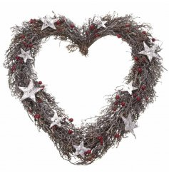A beautifully traditional inspired hanging heart shaped wreath, complete with a glittered snow look and berries