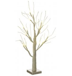 A beautifully glam inspired LED twig tree, covered in a champagne tone glitter