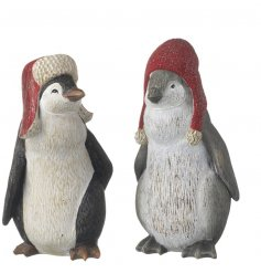 This cute duo of resin based penguin figures will add a warm touch to any festive scene