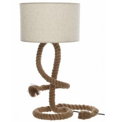Add a discrete nautical sense to any space of your home with this stylishly rustic table lamp