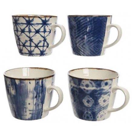 Assortment of 4 blue porcelain mugs