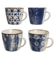 An assortment of 4 blue and white patterned porcelain mugs