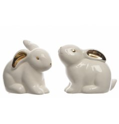 An assortment of 2 white and gold Sitting Bunnies