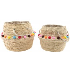 Set of 2 woven baskets with rope handles and pompoms