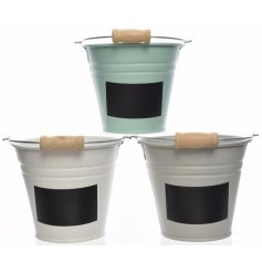 An assortment of 3 iron buckets with chalkboard labels
