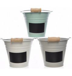 An assortment of 3 medium sized iron buckets with labels