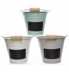 An assortment of 3 small iron buckets with labels