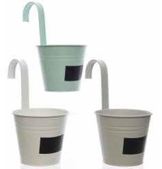 An assortment of 3 iron hanging pots with labels