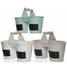 An assortment of 3 double pots with label and handle
