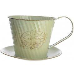 a pale green zinc cup & saucer planter