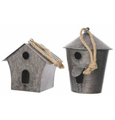 An assortment of 2 Zinc Birdhouses