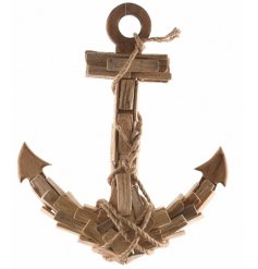 Bring a touch of the coastal feel to your home with this stylish driftwood hanging anchor