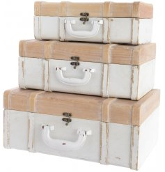 Add a touch of shabby chic to your home with this stylish set of wooden suitcases
