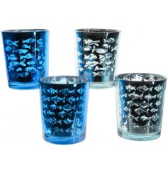 Bring the feel of the ocean into your home with these metallic based glass candle holders