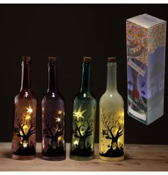 4 beautiful assorted led light bottles, complete with silhouette patterns
