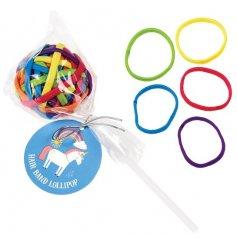 Unicorn themed rainbow hair bands on a lollipop stick