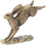 Add a touch of the wilderness into your home with this beautiful posed Hare figure