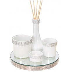 Add a sleek and chic touch to any home with this beautifully set out set of candle holders and diffuser set