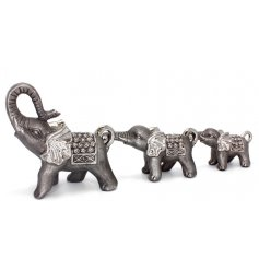 Add an exotic touch to your home displays with this rustic inspired resin set of elephants